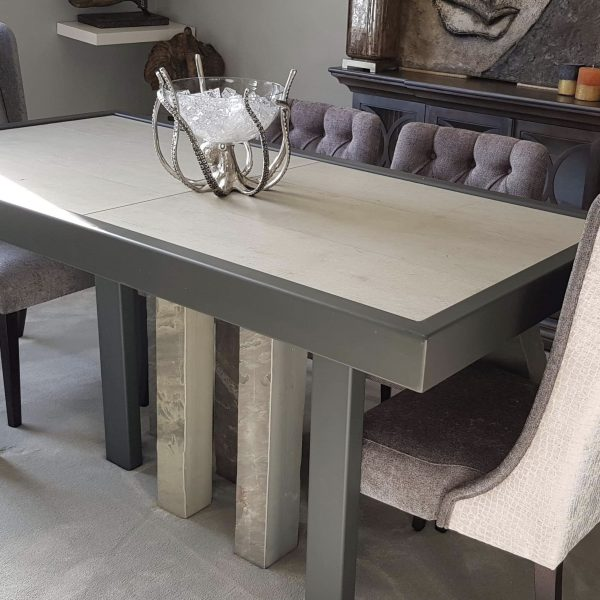 bespoke hand made table with grey steel frame and legs, also stone legs